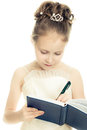 Pretty beautiful girl writing in a notebook on a white background Stock Photos