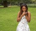 Pretty black girl lighting up her cigarette Stock Photography