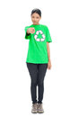 Pretty black haired model wearing recycling tshirt pointing at c camera on white background Stock Images