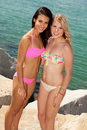 Pretty blond and brunette girls at the beach Royalty Free Stock Photo