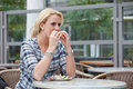 Pretty blond girl eating a bagel Royalty Free Stock Photo