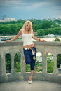 Pretty blond girl is leaning on the wall Royalty Free Stock Images