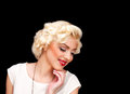 Pretty blond girl model like marilyn monroe in white dress with red lips on black background Stock Image