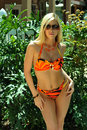 Pretty blond girl wearing bikini in tropical garden Royalty Free Stock Image
