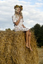 Pretty blond sit on haystack Royalty Free Stock Images