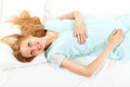 Pretty blond wakes up in her bed at home Royalty Free Stock Photos