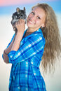 Pretty blond woman cheerful posing with chinchilla Royalty Free Stock Images