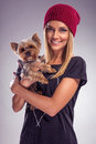 Pretty blond woman dressed in autumn with yorkshire terrier dog Royalty Free Stock Photo