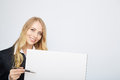 Pretty blonde girl with a blank presentation board Royalty Free Stock Photo