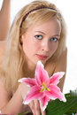 Pretty blonde girl with pink lily Stock Photography