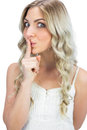 Pretty blonde hiding secret on white background Royalty Free Stock Image