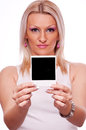 Pretty blonde holding blank instant photo frame isolated on white Stock Photos