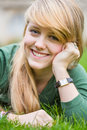 Pretty blonde teen girl candid outdoor portrait of young woman late Royalty Free Stock Images