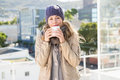 Pretty blonde in warm clothes drinking hot beverage Royalty Free Stock Photo