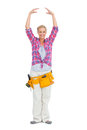 Pretty blonde wearing a tool belt in ballerina pose on white background Royalty Free Stock Image