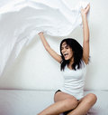 Pretty brunette in bed smiling having fun Royalty Free Stock Images