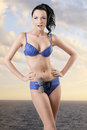 Pretty brunette in bikini with funny expression Royalty Free Stock Image