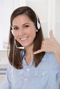 Pretty brunette businesswoman wearing blue blouse with headset telesales or telemarketing Royalty Free Stock Photos