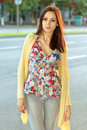 Pretty brunette in flowered blouse posing near the carriageway Royalty Free Stock Images