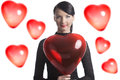 Pretty brunette with heart shaped balloon in front of the camera Royalty Free Stock Photography