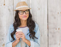 Pretty brunette holding take away coffee Royalty Free Stock Photo