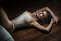 Pretty brunette in sensual position on the floor Royalty Free Stock Photography