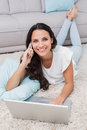 Pretty brunette using her laptop Royalty Free Stock Photo