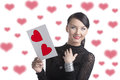 Pretty brunette with valentine postcard smiles Royalty Free Stock Photography