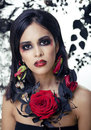 Pretty brunette woman with rose jewelry black and red close up Stock Photos