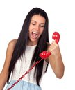 Pretty brunette woman screaming on the phone Stock Photos
