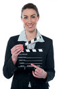 Pretty business lady with clapperboard young corporate woman holding Royalty Free Stock Photos