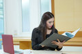 Pretty business lady working at desk model is asian woman Stock Image
