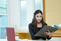 Pretty business lady working at desk model is asian woman Stock Images