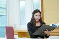 Pretty business lady working at desk model is asian woman Royalty Free Stock Photo