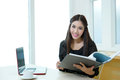 Pretty business lady working at desk model is asian woman Royalty Free Stock Image