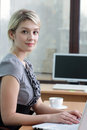 Pretty business woman with notebook in the office young Stock Photo