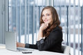 Pretty business woman at office desk Royalty Free Stock Image