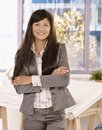 Pretty businesswoman standing in office