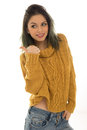 Pretty casual woman giving a thumbs up relaxed young with her hand in the pocket of her jeans standing smiling and of approval Royalty Free Stock Photo