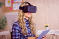 Pretty casual worker using oculus rift in her office Stock Photos