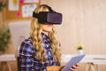 Pretty casual worker using oculus rift in her office Royalty Free Stock Photos