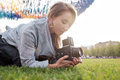 Pretty caucasian female using film photocamera. Traveling woman taking photo on vintage camera outdoor in summer Royalty Free Stock Photo
