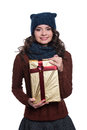 Pretty cheerful young woman wearing knitted sweater, scarf and hat, holding christmas gift. Isolated on white background.