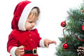 Pretty child decorating Christmas tree Stock Photography