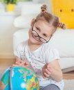 Pretty child girl at home dreaming of travel and tourism, explor Royalty Free Stock Photo