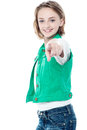 Pretty child pointing you out over white adorable young girl towards camera Royalty Free Stock Photography