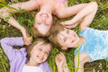 Pretty children and teenager girls on green grass Stock Image