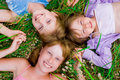 Pretty children and teenager girls on green grass Royalty Free Stock Photos