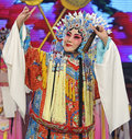 Pretty chinese opera actress with rich adornment in head Stock Photography
