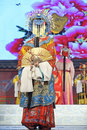 Pretty chinese opera actress with rich adornment in head performs on stage Stock Images